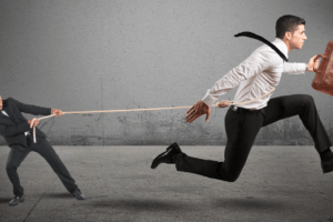 Boss Trying to Hold Employee with Lasso While Employee is Running Away