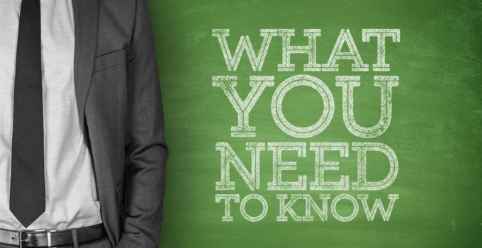 What You Need to Know Written on Green Chalkboard with Businessman Standing to the Left