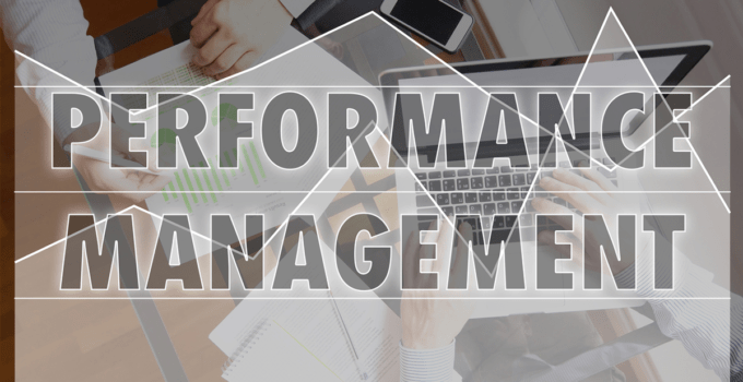 Performance Management Transparent Graph Layered on Top of Person Working on Computer at Desk