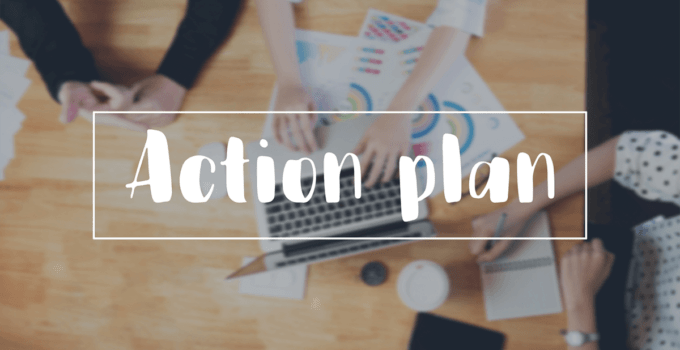 Action Plan Written in Fun Font Over Background of People's Arms Working Together at Large Table