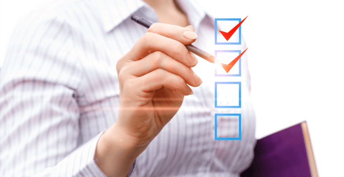 Businesswoman Checking Hovering Check Box Icons in Front of Her