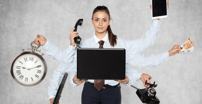 Multitasking Businesswoman with Multiple Arms all Holding Various Business Items