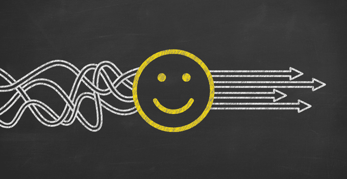 White Squiggly Lines Drawn on Chalkboard Leading into Happy Face and Coming Out Straight on the Other Side